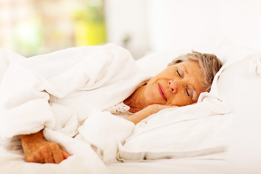 Senior woman sleeping peacefully in bed
