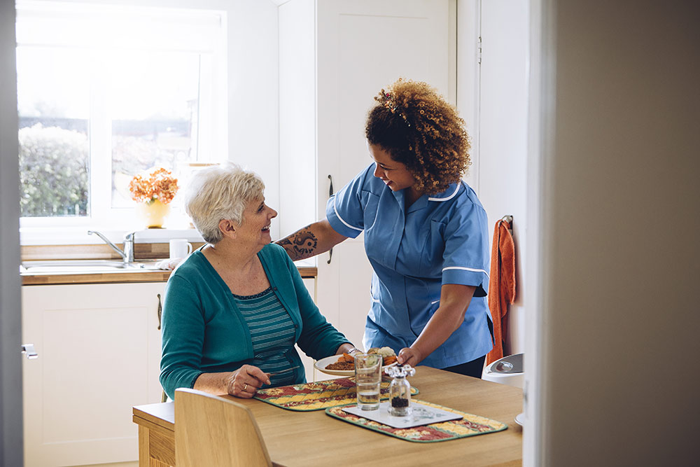 Senior woman with caregiver in dementia care assisted living
