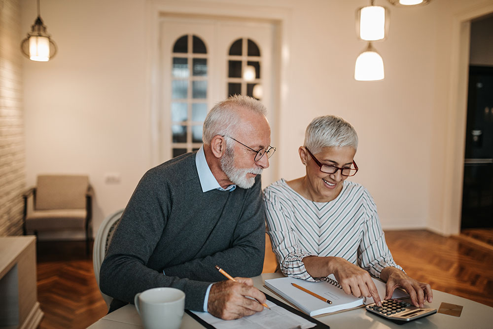 Senior couple going over expenses and budgeting for retirement