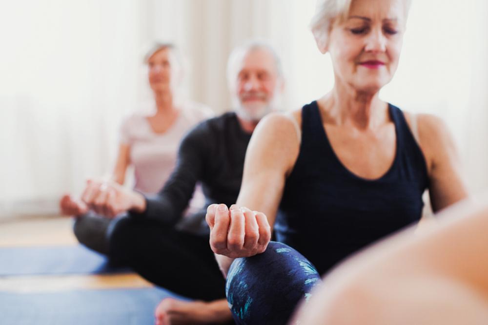 Seniors practicing mindfulness yoga